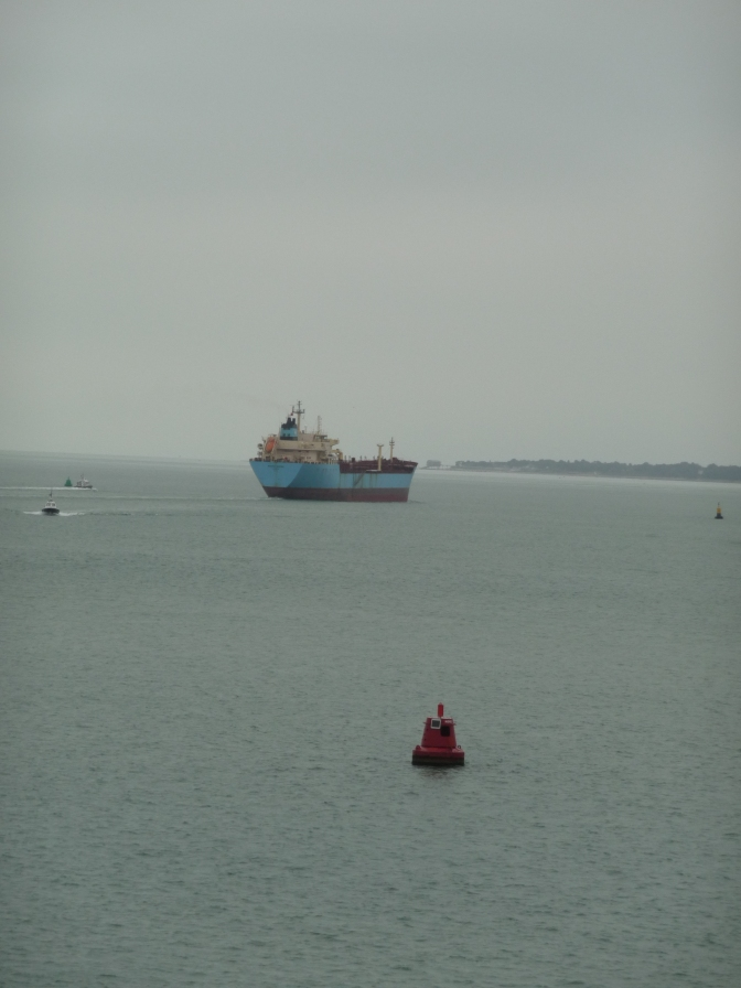 We followed this ship through the mouth of the harbour. How incredibly bright its colours were in the grey of sea and sky.