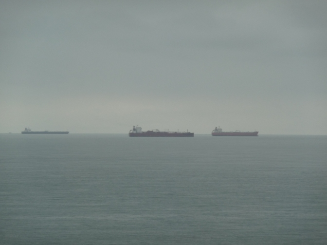 These great liners move silently through the fog.