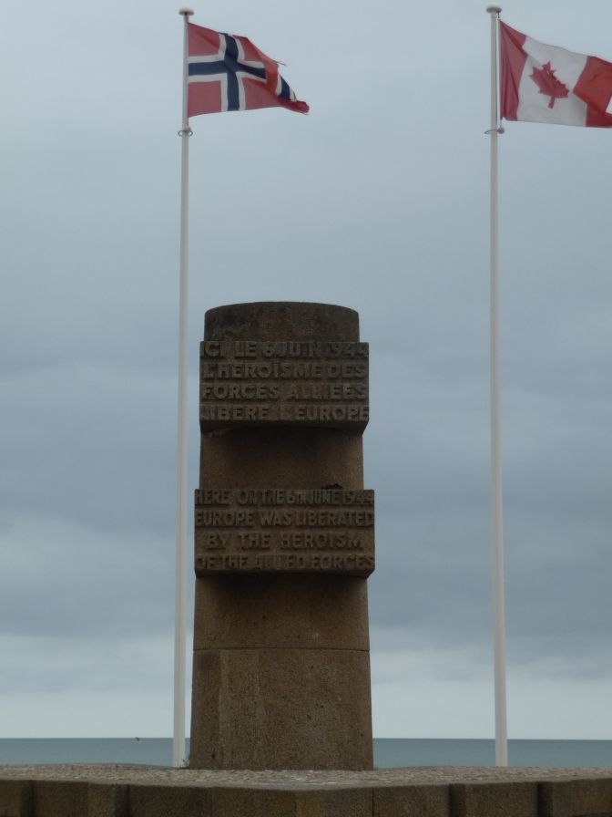 Set on a large plinth and bearing the flags of the Allied Forces, this is one of nine such monuments on the beaches of Normandy.