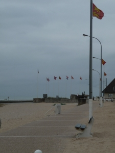 Down the row of flags, the Pillbox on the beach.