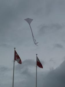 A child's kite soars.