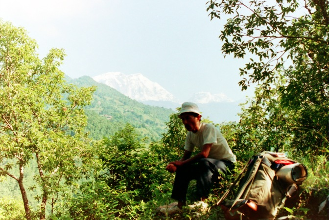 Nirkumar, sitting on top of a hillock, on top of the world.