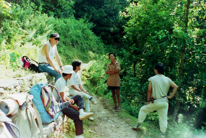 Nirkumar and Om in front, chat with a local man and our two trekking leaders (one in training) shortly after departing our first camp.