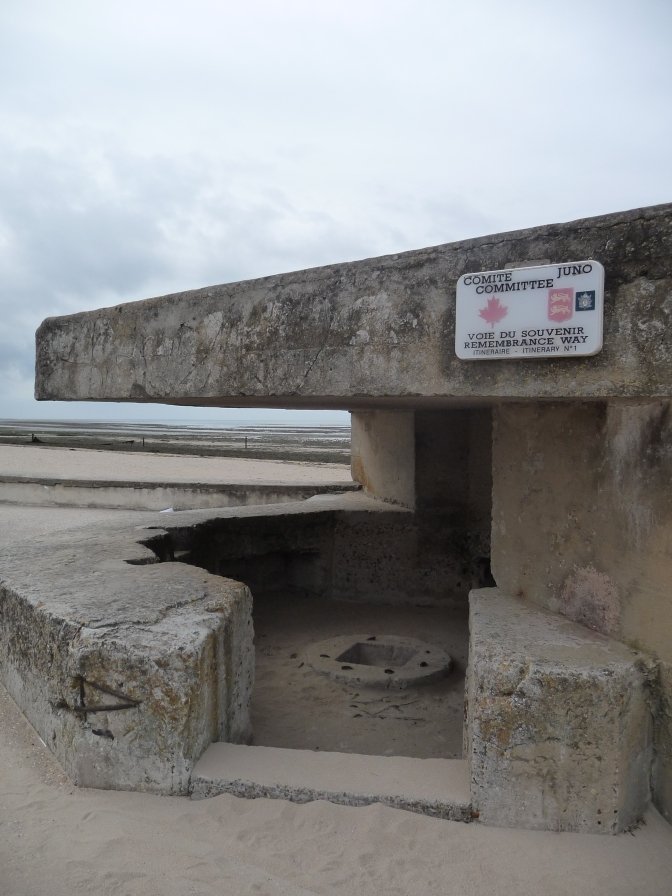 A German pillbox, one of countless visible reminders in France, serves as a Monument to the  Canadian troupes who stormed Juno Beach on June 6, 1944.