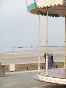 The Merry-Go-Round at the shore, the Mulberry Harbour in the distance. The cycle of life.