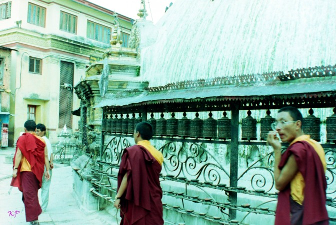 Monks walk the perimeter of the stupa at Swayambunath.