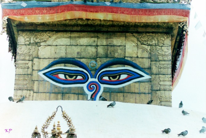 The Primeval Eyes of Buddha emanate from all Stupas. The question mark shaped figure at the nose is the Nepali symbol for the number one, representing the unity of all.
