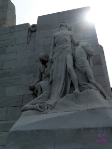 'Sympathy of the Canadians for the Helpless' - they rest at the north corner of the face of the memorial, looking out and mourning for the people of the lands beyond.