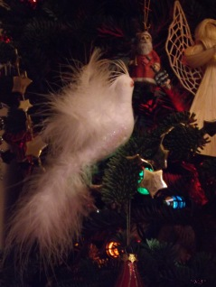 Dad had these birds on his tree, Mum put the Santa in my stocking a few years back. The stars were with the pine cone and bell Mum gave me for my first tree.