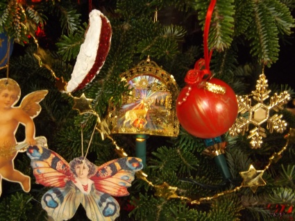 Similar grouping, but shifted to the right, where the old memories are joined by a pretty red bauble I saw in a charity shop once and a gold snowflake that was attached to a Christmas gift one year.