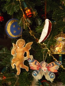 My sister and nieces worked on the moon and stars ball; Mum taught me how to make the mildweed pod ornament. Mum gave me the Victorian angel, while Dad had the light reflecting deer ornament. The butterfly was a Valentine, but I love it on my tree.