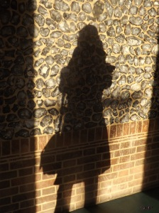 Caught taking a picture of the amazing stone wall at Virulamium Museum, her shadow self stands quietly, contemplating the beauty.