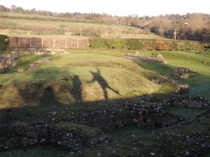 From the top of the wall surrounding the theatre, we perform a shadow play on the mound covering a bank of seats.