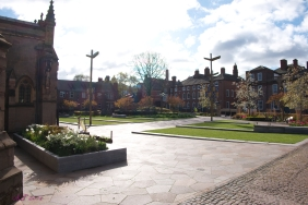 The cobbles past the Guildhall lead to the marvelous Cathedral Gardens. The entire square in front of the Cathedral was redone for the interment of Richard III in March 2015. It has created a great open area and there are often people sitting on the benches. The buildings opposite are Peacock Lane. This lane used to house the Franciscan Grey Friars Priory, which is where Richard III was taken after his death. The Richard III museum is located atop the parking lot of Grey Friars Social Services where Richard III's body was finally found in 2012.