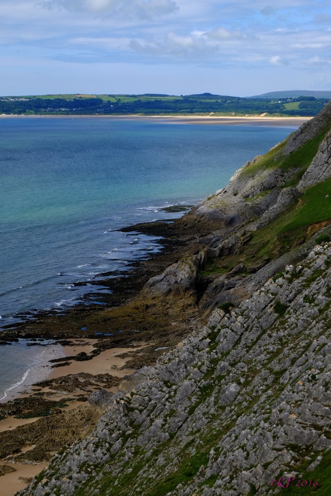 Looking from the West Cliff at Heatherslade toward Oxwich, the cliffs's patterns have been formed by eons of tides, as the waves create new patterns with every touch of the shore.