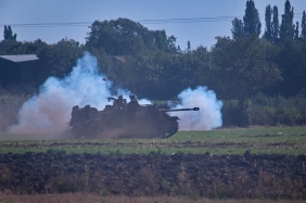 A German tank comes through the smoke.
