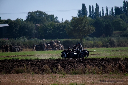 A German motorcycle races across the field.
